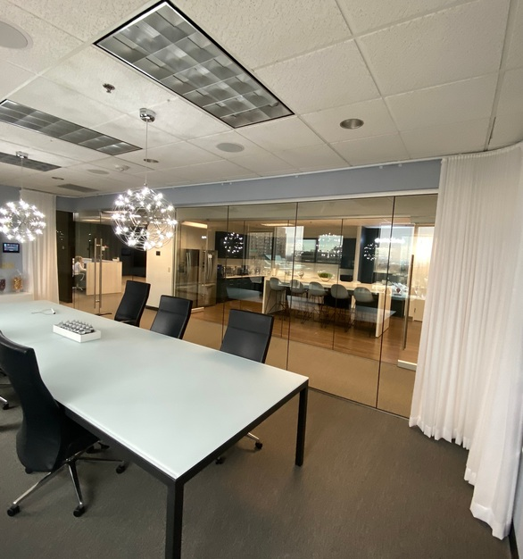 The perfect addition to this conference room is the drapes to provide privacy but they only work because of American Track Supply's flexible aluminum track.