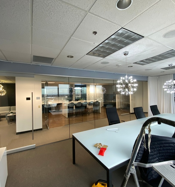 A spacious conference room with bright open windows is great but for privacy use American Track Supply's flexible aluminum tracks for the curtains that are needed.
