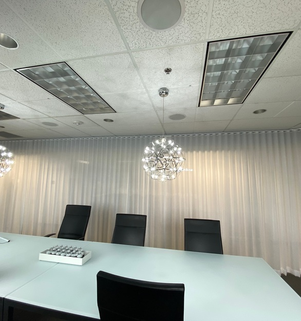 Sportsdigita has a large open conference room that requires privacy when need. American Track Supply provided their flexible aluminum tracks for this space.
