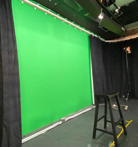 This high school used American Track Supply's wall-mounted flexible curtain track to customize how much green screen shows.