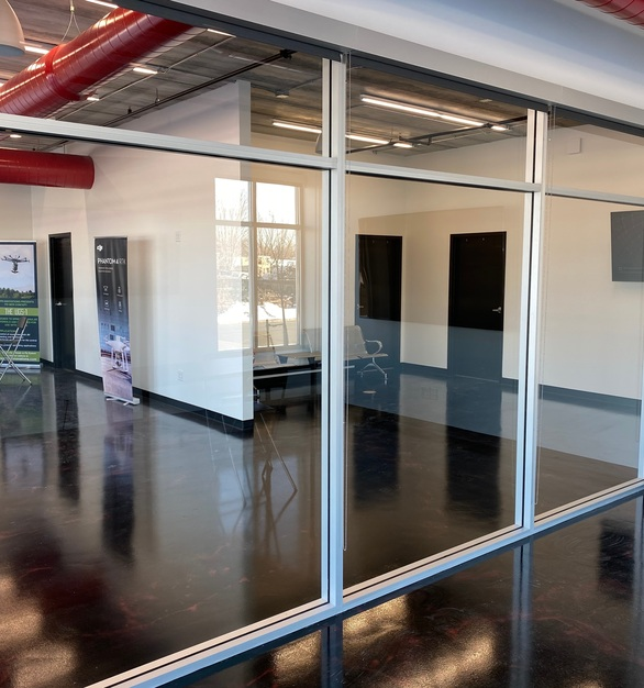 American Drapery Systems rolling commercial shades are perfect for privacy while in the office. Seen here in an office space conference room.