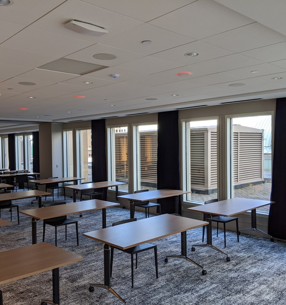 A classroom/training room can be found at the Wells Fargo Center in Minneapolis and it showcases American Drapery's Americantracksupply.com custom drapery tracks.