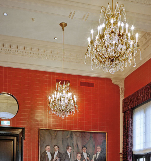 These elegant chandeliers by Swarovski Lighting accents the beautiful historic molding in this Concert Hall.