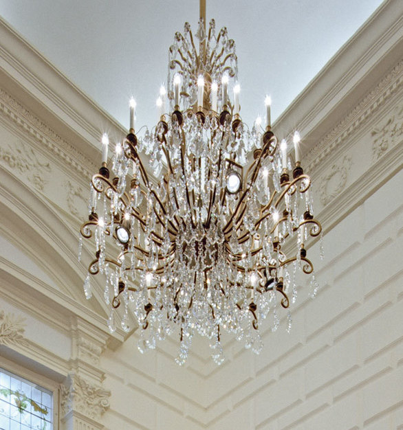 This elegant chandelier by Swarovski Lighting accents the beautiful historic molding in this Concert Hall.