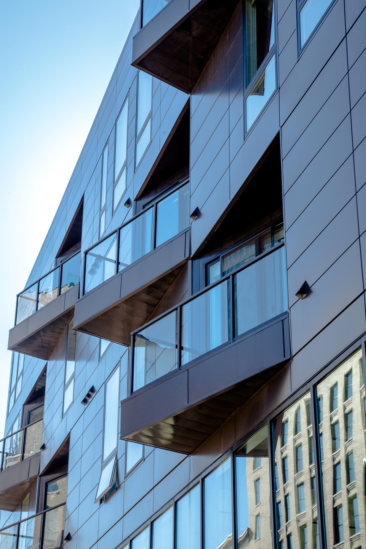 The patio designs at the 915 Washington Avenue North apartments gives the building a unique exterior look. Andersen® Windows provided their 100 Series windows for the project.
