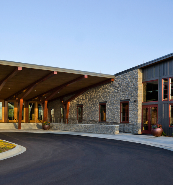 The eye-catching exterior at the Hazeltine National Golf Course Clubhouse uses natural building materials and features the Andersen® A-Series windows and patio doors to complement the country club retreat theme.