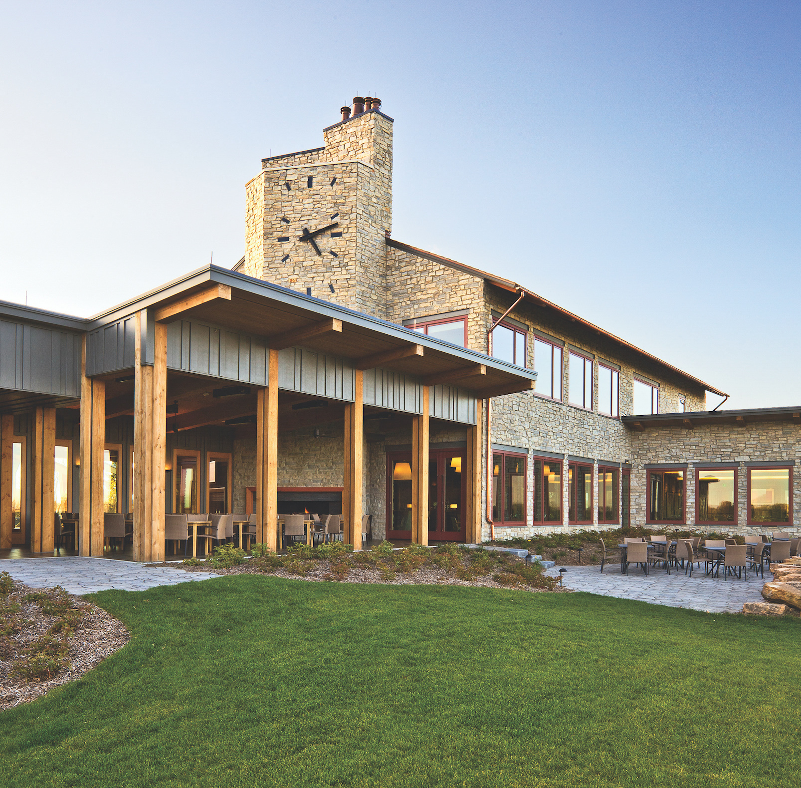The unique red rock exterior at the Hazeltine National Golf Course Clubhouse is complemented with Andersen® A-Series windows and patio doors because of their versatile design.