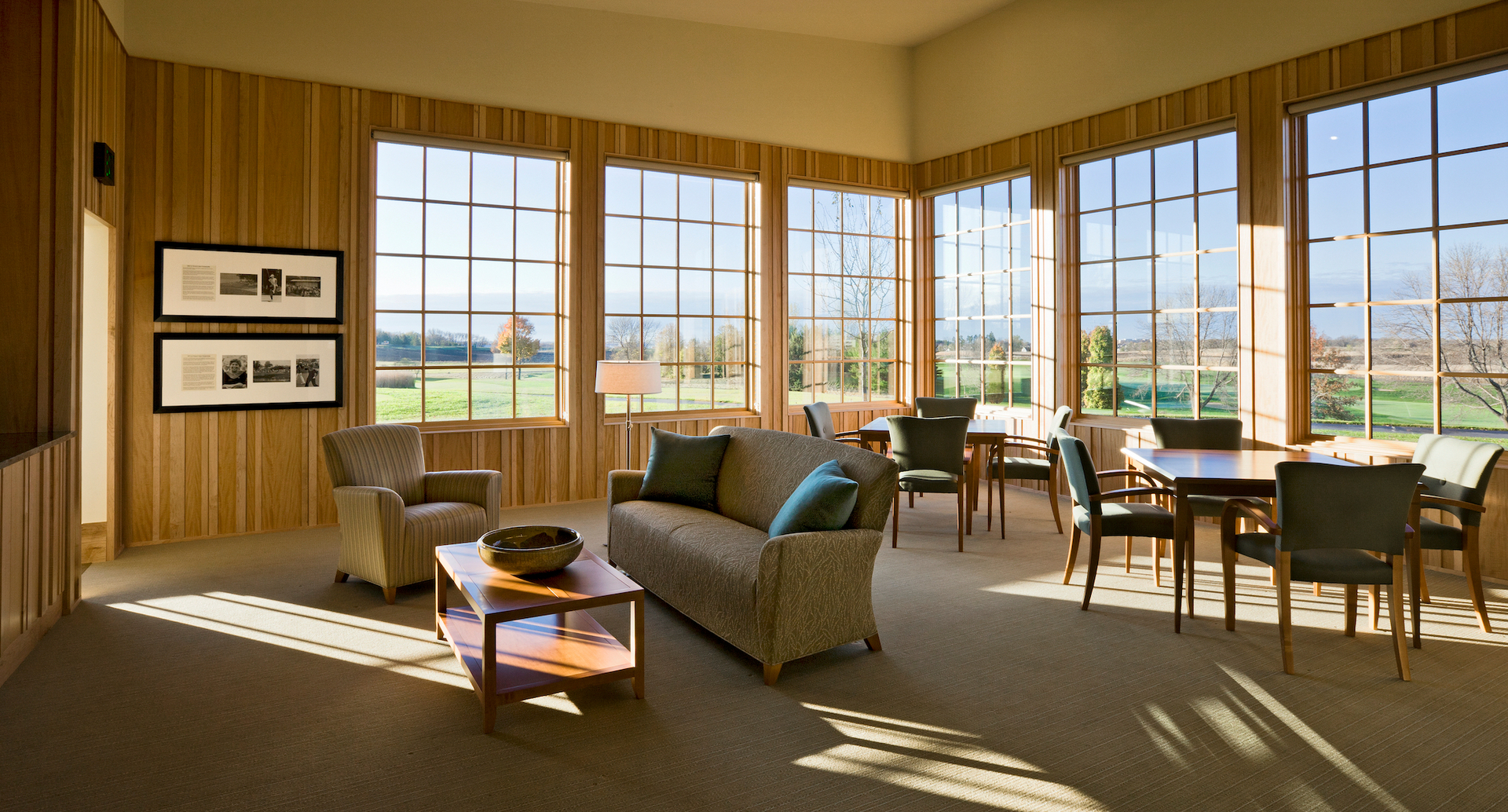 The natural wood interior of the Hazeltine National Golf Course Clubhouse featuring the Andersen® A-Series windows to complement the overall building theme.
