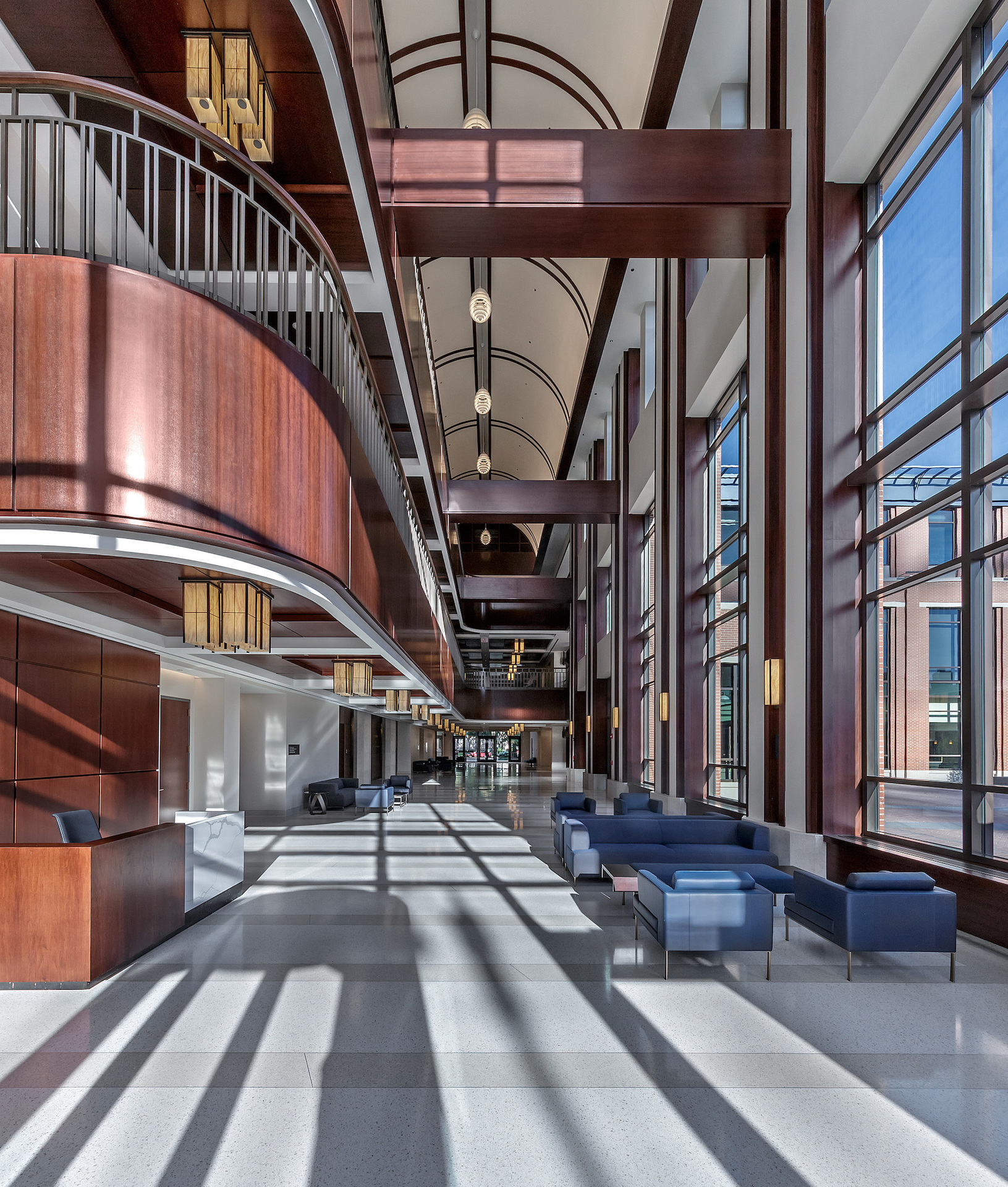 Move freely in this spacious reception and lobby at The DePaul University Holtschneider Performance Center in Chicago, Illinois, designed by Antunovich Associates.