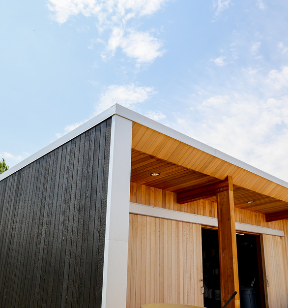 Arbor Wood's used their charred Brnsh Pine 210 Siding for the exterior of the Tashjian Center.