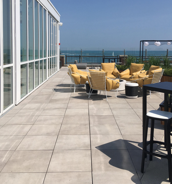 """Archatrak 24"""" x 24"""" porcelain pavers in the color 'Cemento' were chosen for this project and coordinate perfectly with the cement paving used elsewhere on the Pier."""