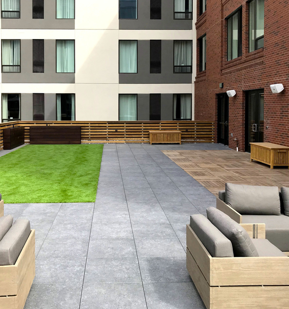 Construct solid Ipe wood decks over sloping or uneven surfaces with structural wood pavers supported by adjustable height pedestals.