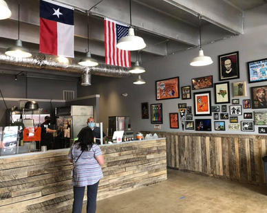 The interior of Shotgun Willie's BBQ was created by both Lyne Interiors and Archuity Architecture.