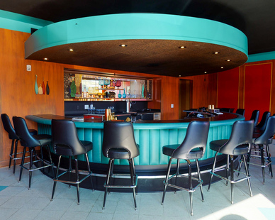 Beautiful round interior bar with retro-like color and design. 