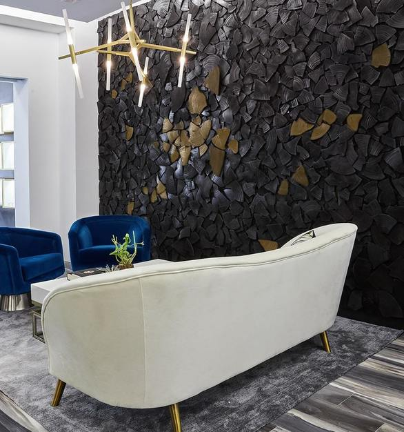 ASI Architectural Systems' Fusión Wood Panels bring the Fabrikant Jewelry store to live. The feature wall was brought together using chard wood nuggets and brings to mind the coal that many of Fabrikant's gems originate from.