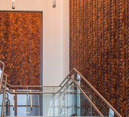 ASI Architectural Systems' Crossfuse® Wood Panels - Ironwood LSG Sky Chefs Facility interior staircase