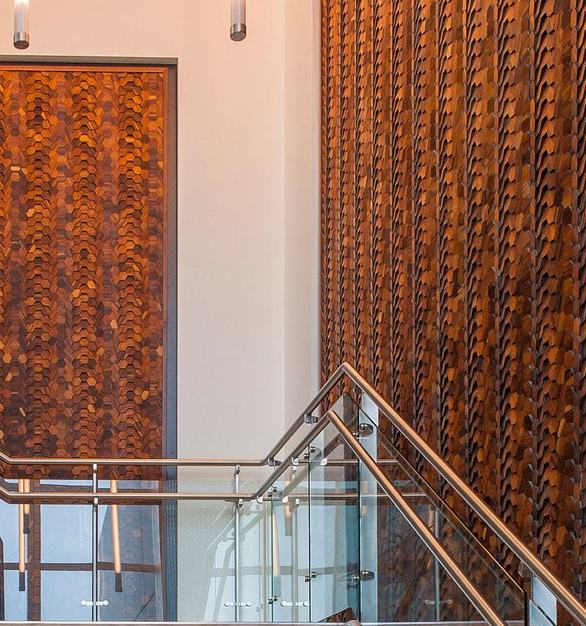 The grand staircase of the LSG Sky Chefs facility is located in the main lobby and showcases ASI's Crossfuse® Wood Panels, complementing their dedication to culinary cuisine and sustainable building excellence.  PhotoCourtesy ofWalker Miranda Design Studio