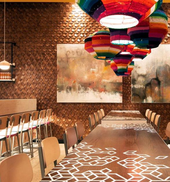 ASI's Crossfuse® Wood Panels was selected for the feature wall at the Nandos Kitchener because of the warmth and texture it provides.  Photo Courtesy of IV Design