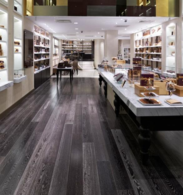 ASI Architectural System's custom hardwoods were selected for the flooring solution in the Godiva retail location.  Photo Courtesy of dash design
