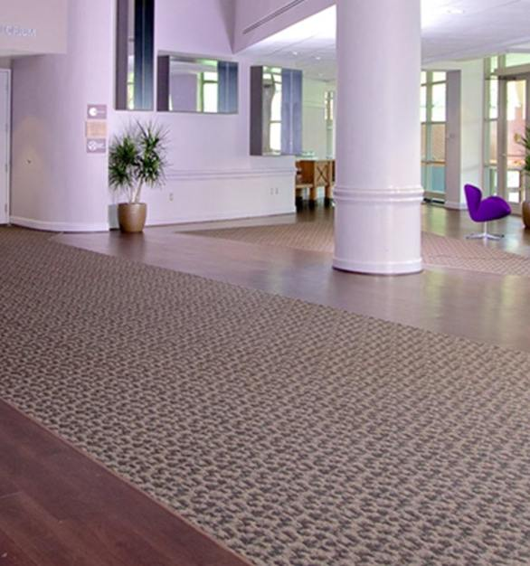 The design team of the Kellogg Conference Hotel selected ASI Eco-Tech® Resilient Flooring to run through the lobby of the hotel.  Photo Courtesy of Robelan Displays Inc.