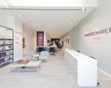 Madison Reed's in-house design team selected beautiful custom products for multiple locations of their salons, including custom Organic Vinyl Wood Plank flooring and the intricately-detailed Crossfuse Wood Panels featured on this custom reception desk.