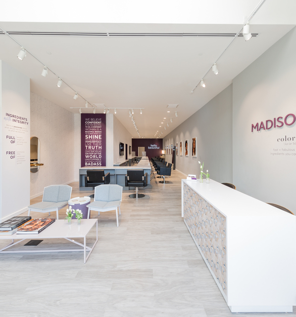 Masison Reed's in-house design team selected beautiful custom products for multiple locations of their salons, including custom Organic Vinyl Wood Plank flooring and the intricately-detailed Crossfuse Wood Panels featured on this custom reception desk.