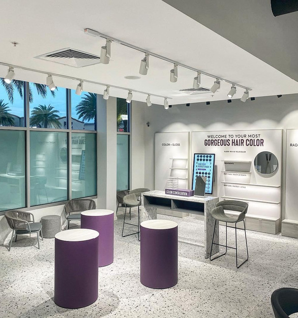 Browse the retail shop for the perfect color while you are waiting for your appointment or after.  The custom track lighting and lighted shelves to promote the products.  The terassa porcelain floors add the perfect finishing touch to this space.
