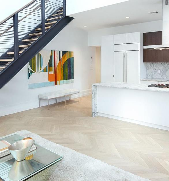 The Allen House suite features Grenada Hardwoods by ASI Architectural Systems in a stunning chevron pattern.  Photo Courtesy of Studio V Architecture