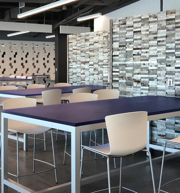ASI'sMetal Fusión Panels in Steel was selected by the ID Unique Solutions design to create the impactful focal wall in the DealerTrack Technologies employee dining hall.  Photo Courtesy of ID Unique Solutions