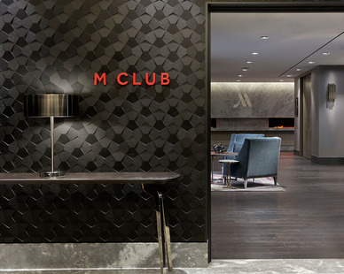 Crossfuse® Wood Panels by ASI Architectural Systems creates a stunning geometric texture to the entrance of the Marriot M Club Lounge.