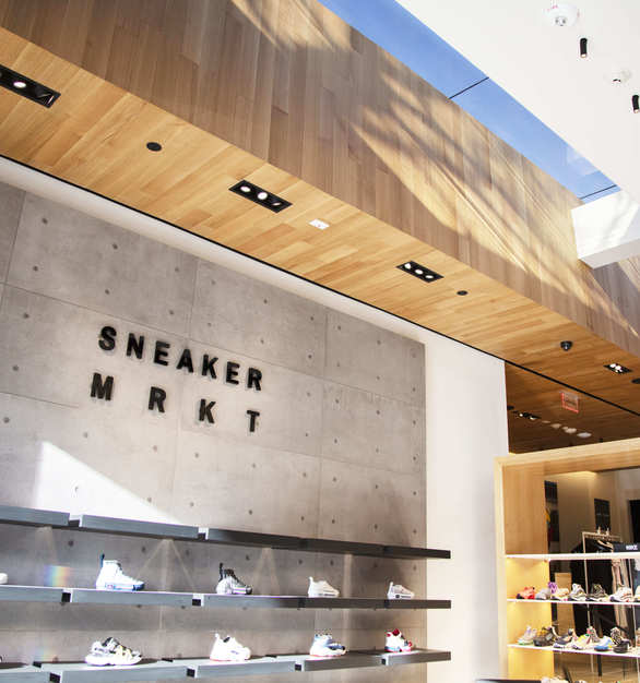 Serenity Redux® Engineered Hardwood by ASI was selected as the ceiling solution that helps warm up the interior of the Sneaker MRKT at Hirshleifers.