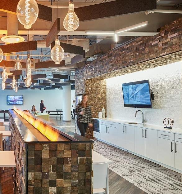 Featured on the interior fireplace and walls on the Westbrook Corporate Center Wifi Lounge is ASI Architectural System dimensional Fusión Wood Panels from Reclaimed Wine Barrels.  Photo Courtesy ofWhitney Architects