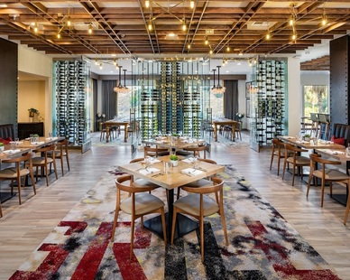Atwater Inc. Studio designed this Italian restaurant to reflect a vibrant and industrial space that projects casualness as it enhances the dining experience.