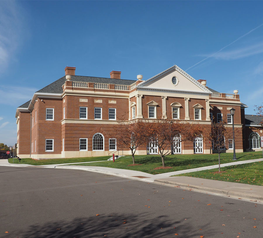 Providence is a Catholic school with a new addition that's downright heavenly. It features poured foundations and stairs, tiered theater seating, 130,000 bricks, jack arches, and multiple precast elements.