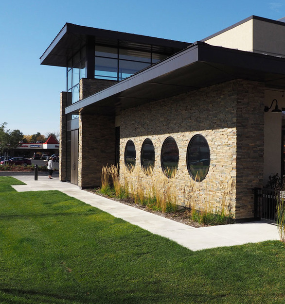 Custom stonework on the exterior of the Tavern Grill located in Roseville, MN, by Axel H. Ohman.
