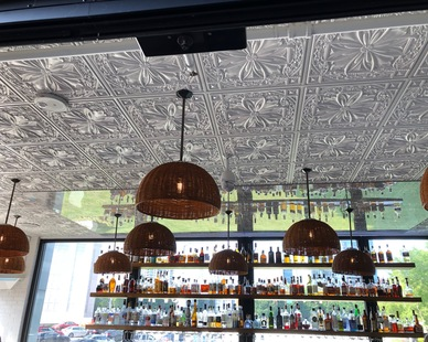 Look up to appreciate the detail of the ceiling tiles at this bar and restaurant.