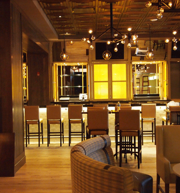 Enjoy a cool drink at this lavish bar with gorgeous ceiling tile.