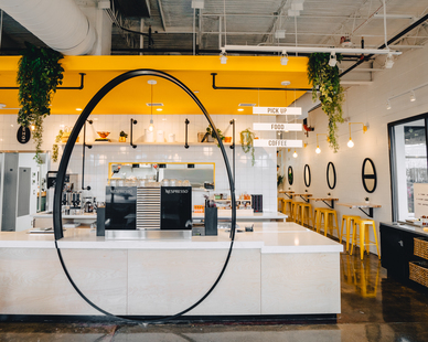 The ordering counter's bright finish meshes well with the yellow accent colors throughout EggHaus, including the Downtown Swing Arm Sconce in buttery yellow by Barn Light Electric.