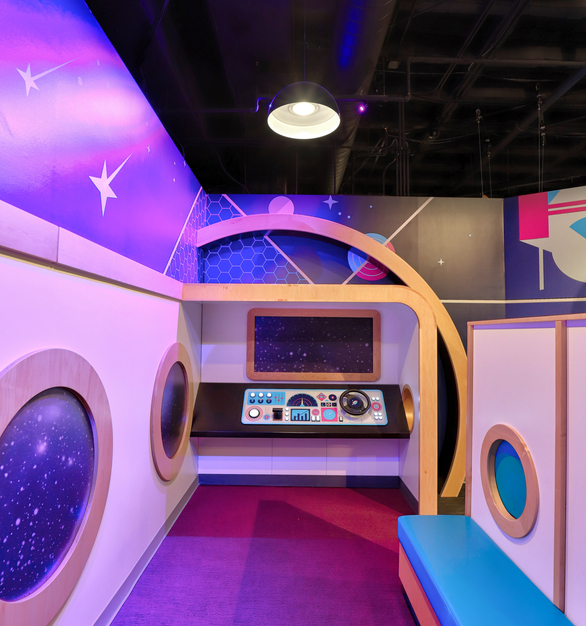 Play along with your children, or even if you are a child at heart--enjoy this fun space exhibit at the museum.  The  bright graphic prints on the wall complete the look and make you feel like you are in space.