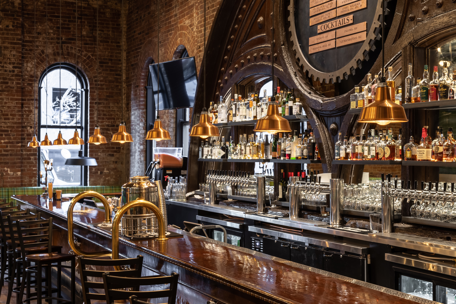 The vintage bar, situated on one side of the space, was once owned by Colorado native and boxing legend Jack Dempsey who fought in the early 1900s. The previous tenant had it installed in the early 1970s, and Chris was thrilled to incorporate this piece of history into the restaurant. The architect chose to highlight the bar with 11 Avalon Pendants crafted from Raw Copper.