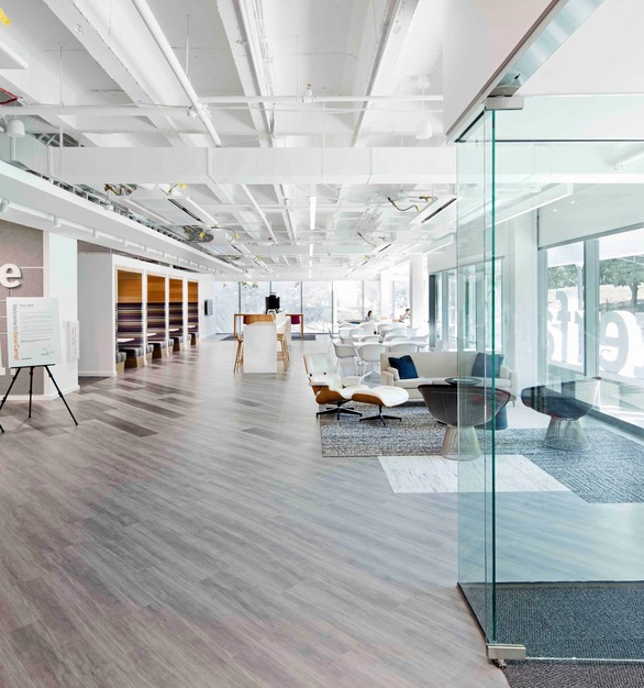 When you first step into Base Camp, you're immediately welcomed into the building by the open reception area. Because the first floor is also at street level, it reflects the urban energy and activity that connects the building's occupants to the neighborhood around it.