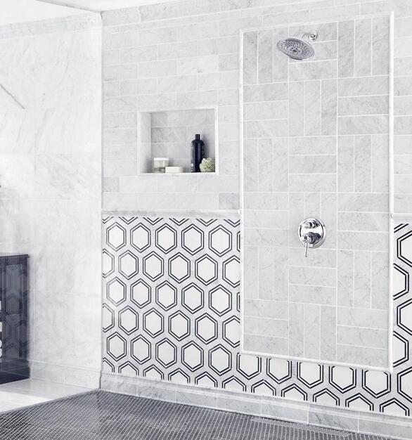 These marble wall tiles give a high-end look at a reasonable price, and they are fairly easy to maintain.