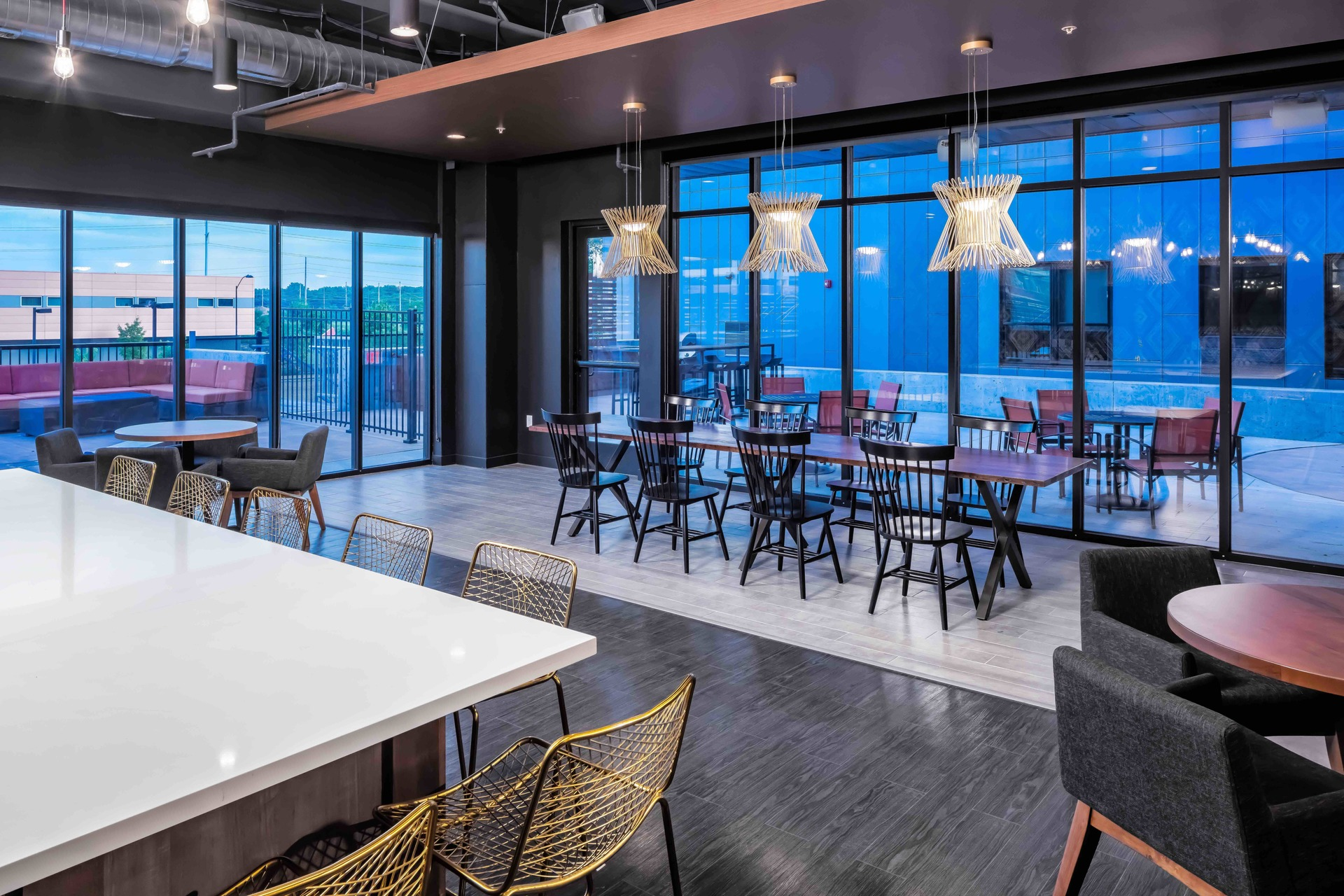 Indoor Club Room at the Flux apartments in Des Moines, IA, by Bauer Design Build. Photography by Brandon Stengel - www.farmkidstudios.com Instagram:  @farmkidstudios