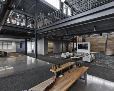 The natural light with exposed industrial finishes enhanced by a simulated lagging around this 2-story office building makes this an unforgettable office building.