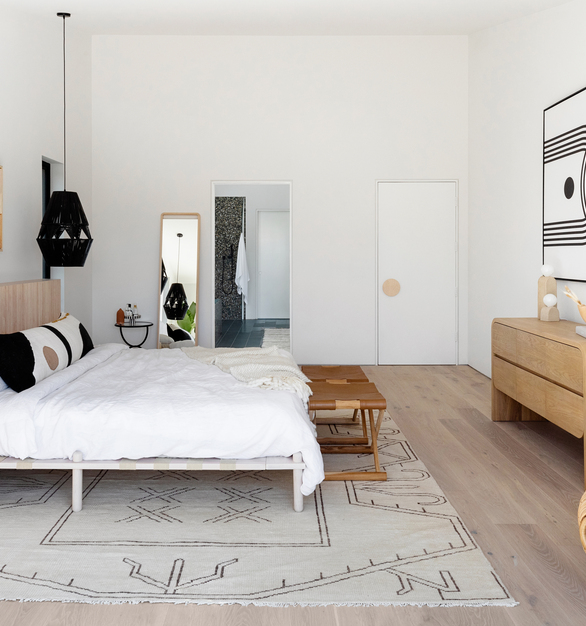 This gorgeous bedroom has many accents of wood.  Surfacing Solution Solid Wood Tambour panels are used as the headboard.