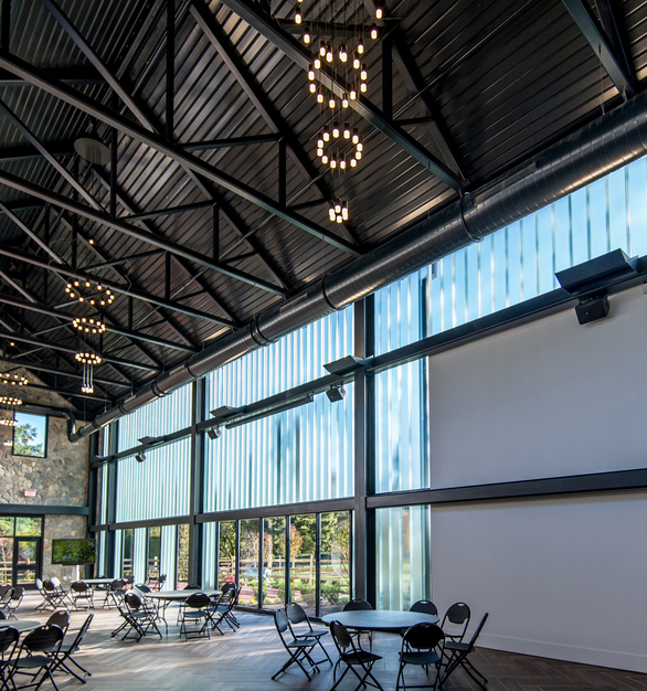 The low-e coated channel glass achieves U-Value of 0.41 and approximately 64% VLT (visible light transmittance). Photo by Billy Economou, courtesy of NK Architects.