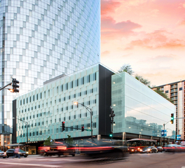 Bendheim ventilated glass parking facade at dusk