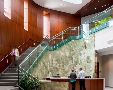 This elegant stairway at the Dan Abraham Healthy Living Center in Rochester, Minnesota features warm wood panels and a stunning skylight.