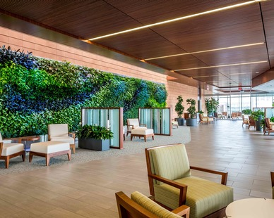 The modern lobby area at the Dan Abraham Healthy Living Center features a 60 ft GSky VERSA WALL® that helps removes toxins from the air while emitting oxygen enhancing the indoor air quality of the space.