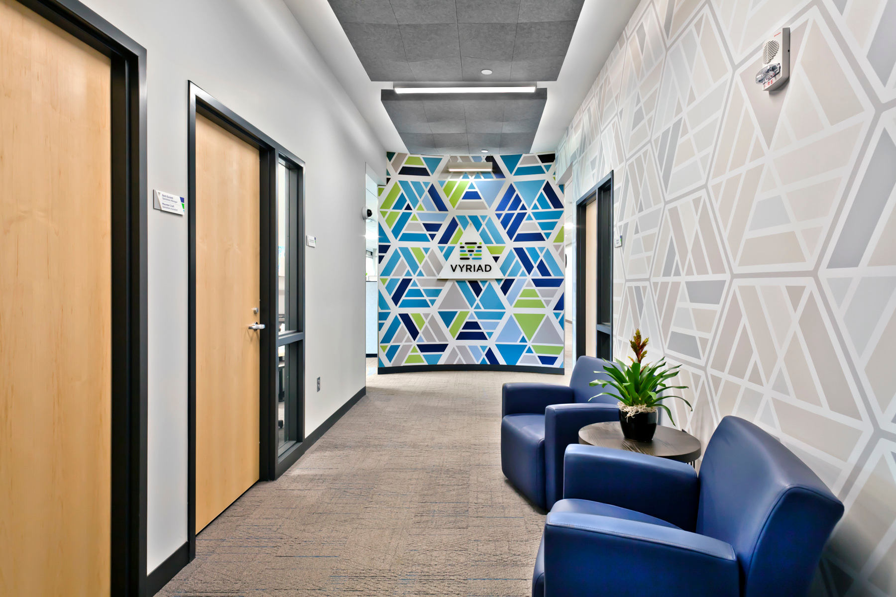 A spacious hallway can be found outside private offices at the Vyriad office in Rochester, Minnesota.